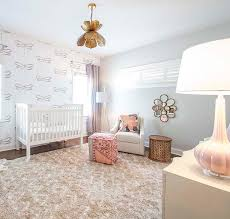 pink and gray nursery with gold lotus flower chandelier