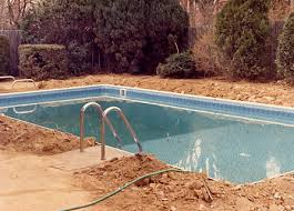 after the pool is filled with water and backfilled dirt the to fill in area around walls dive board stands ladder rail filling a swimming83