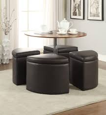 round table with chairs underneath designs