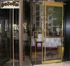 next door the botero restaurant uses a stylized laminated glass interlayer in the doors