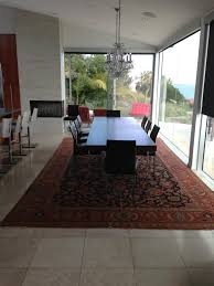this antique traditional oversize rug completed the look of this architecturally modern designed home