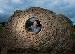 original resolution on stone wall artist with stonemason johnny clasper creating a new dry stone wall sculpture in