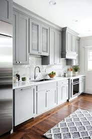 grey quartz countertops white cabinets shaker style kitchen cabinet painted in the walls are dove wing
