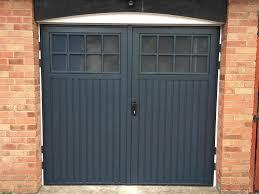 hinged garage doors side