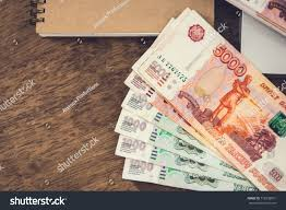 russian ruble rub money banknotes on a wooden desk with a notebook financial