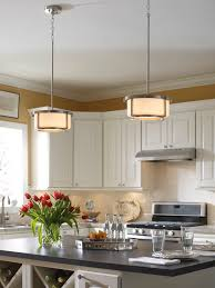 pendants should be hung at a height that doesn t block views across the kitchen featured pendants progress lighting s dynamo collection