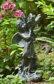 garden statue with aged verde finish cast in resin height 43 cm