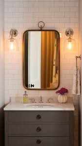 bathroom sconces. exquisite bathroom features a nook filled with subway tiled accent wall lined gray sconces y