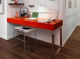 wall mounted red desk with modern desk lamp and white plastic desk