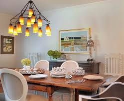 view in gallery lovely dining room with sara chandelier in warm amber