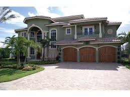 multi level spanish stucco home with tile roof