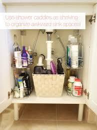 drawers to fit under bathroom sink. under sink? (kitchen too!) 12 genius storage tricks for a tiny bathroom - shower caddy drawers to fit sink