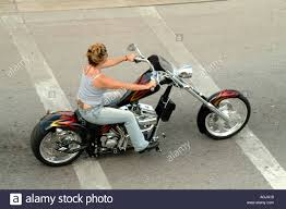woman biker on customised stretched pan head harley davidson motor