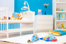 baby boys furniture white bed wooden. bold blue wall paired with white wood furniture in this nursery for boys complemented by baby bed wooden