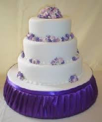 Lilac Abbeydale Wedding Cake In White With Small Purple Flowers