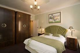 art deco bedroom with grey walls and art deco furniture with abstract wall arts art deco style bedroom furniture