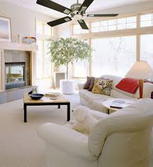 white ceiling fan with chandelier. furniture, white sofa carpet floor wall black brown wooden table ceiling fan chandelier pillow: with