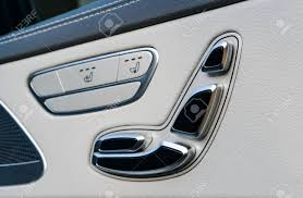 luxury car interior seats. Exellent Interior Banque Du0027images  Door Handle With Power Seat Contol Buttons Of A Luxury  Passenger Car White Leather Interior The Modern Modern Car  Throughout Luxury Car Interior Seats E