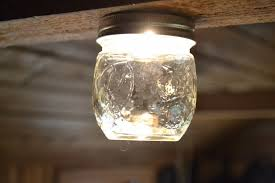 off grid light made from 12 volt car back up light bulb and a canning jar