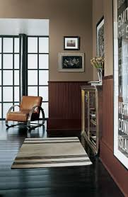 Two-tone urban style from Ralph Lauren Paint, with Greenwich Tan above and  Harrow Brown on the wainscoting below. Possible loft color.