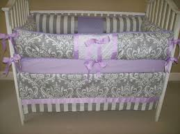 cool gray and purple crib bedding set with traditional motif