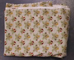 A quantity of modern fabric, including Laura Ashley lemon printed cotton,  and a pair of brown and ye