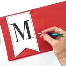 print and trace letter pennant on to tissue