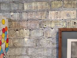 brick wall showing excessive art display damage