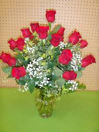 v240 over the top arrangement of 2 dozen red roses