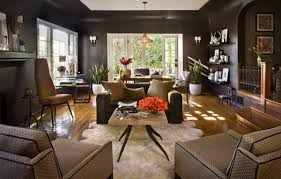 if you love the look of dark brown walls check out this living room design the dark walls are nicely balanced with light brown furniture and orange