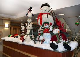 Cluster of festive snowmen winter holiday scene created by Interior  Tropical Gardens