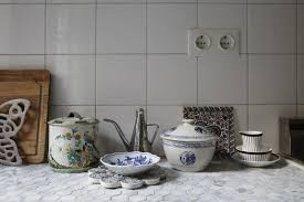 usual white tiles on the backsplash and hexagon penny tiles on the countertop