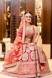 Designer Lehenga Facebook Bride In Red Bridal Lehenga And Gold Big Motifs Indian
