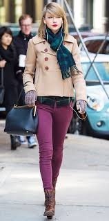 taylor swift wearing beige pea coat navy and green plaid dress shirt purple skinny jeans dark brown leather lace up ankle boots women s fashion