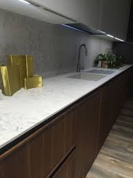 marble backsplash decorated with gold accessories