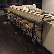 diy sofa table serves as a bar and gives a modern industrial style to the room