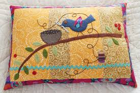 How to Make Quilted Pillow Covers: 6 Patterns to Try & bird on a quilted pillow Adamdwight.com