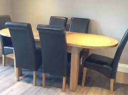 canterbury oak oval extending dining table 6 brown faux leather chairs