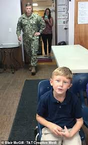 Tear-jerking moment a Navy commander surprises his son, 10, after ...