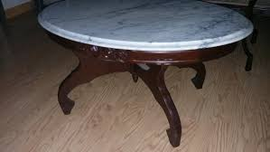 rose carved mahogany coffee table with marble top