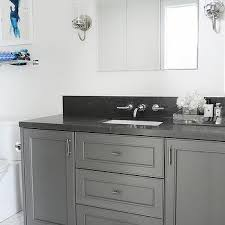 dark gray washstand with black granite countertop