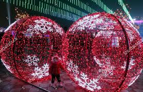Kyrgyzstan Red Light Area Child Walks Past Illuminated Christmas Decorations Central