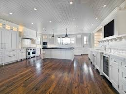 kitchen extra wide kitchen design solid oak wood floor white wooden ceiling with minimalist lighting white wooden island with black granite top white