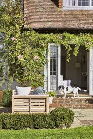 Relaxing front yard fence remodel ideas Homystyle Rose Door Frame Arch Landscaping Idea Country Living Magazine 65 Best Front Yard And Backyard Landscaping Ideas Landscaping Designs