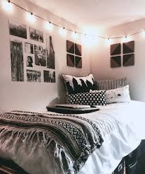 rather a neutral room with boho blankets, black and white pictures