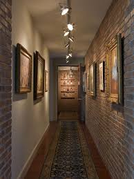 industrial track lighting systems. Industrial Hallway With Artworks That Are Highlighted Track Lights Lighting Systems