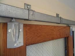 closet door tracks doors hung from ceiling mounted sliding panels bypass closet barn closet door without