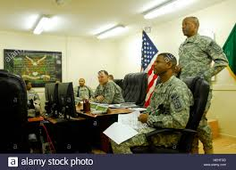 Col. Byron Freeman (standing), commander of the 8th Military Police Stock  Photo - Alamy