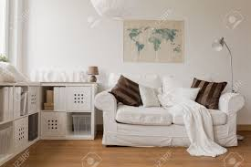 White Couch Living Room White Sofa And Commode In Cozy Living Room Stock Photo Picture