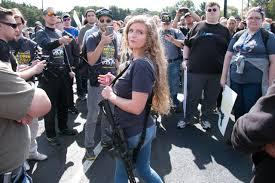Kent State '<b>gun girl</b>' Kaitlin Bennett flees hundreds of protesters at ...
